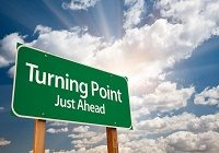 Turning Point Green Road Sign and Clouds